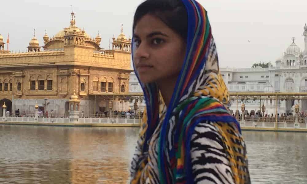 golden temple with female devotee